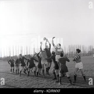 1960s, historical, picture shows an amateur rugby union match and the the two teams forwards competing for the ball - Stock Photo