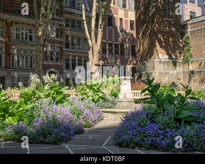 POSTMAN'S PARK, LONDON: View along one of the paths in the Park showing the centre of the gardens - Stock Photo