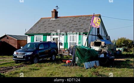 UKIP flag flying next to shack on the shingle at Dungeness, Kent, England UK - Stock Photo
