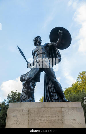 View of large bronze statue of Achilles in Hyde Park London W1 erected in honour of Arthur Wellesley, 1st Duke of - Stock Photo