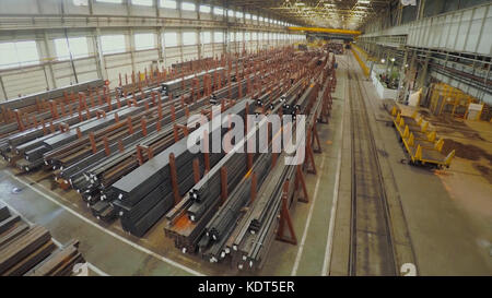 Old factory of auto components production. Warehouse of an aluminum pipes. the production of metal pipes. Pipe welding. - Stock Photo