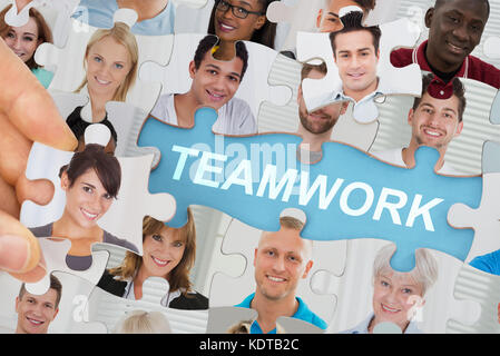Teamwork Concept With Multicultural Business People Team On Jigsaw Puzzle - Stock Photo