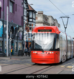 Red Incentro AT6/5 model Tram, Goldsmith's street, Nottingham - Stock Photo
