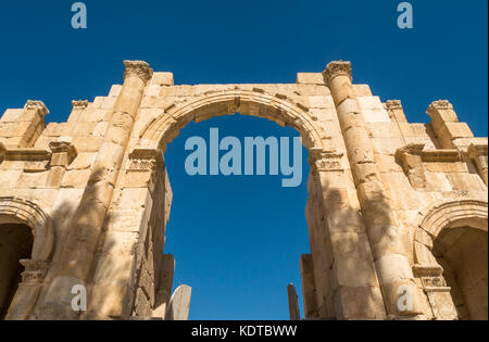 Looking up at Hadrian's Arch gate, South side of Roman city of Jerash, ancient Gerasa, archaeological site, northern - Stock Photo