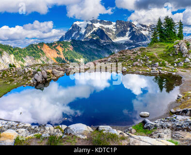 Mount Shuksan Pool Reflection Summer Artist Point Mount Baker Highway Pacific Northwest Washington State Snow Mountain - Stock Photo