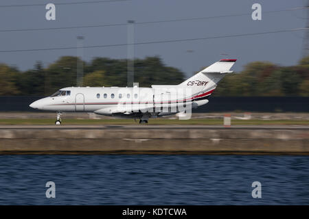Raytheon Hawker 850XP Landing at London City Airport - Stock Photo