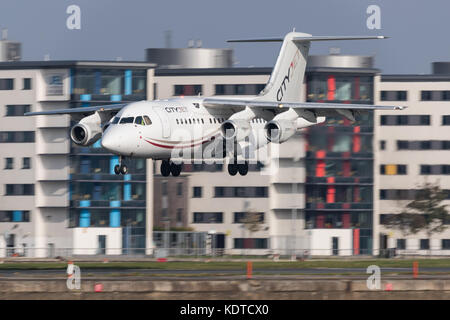 City Jet Avro RJ85 landing at London City Airport. - Stock Photo