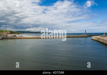 Whitby harbour entrance breakwaters and lighthouses - Stock Photo
