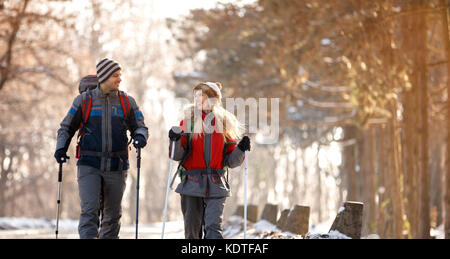 Young boy and girl skiing in forest - Stock Photo