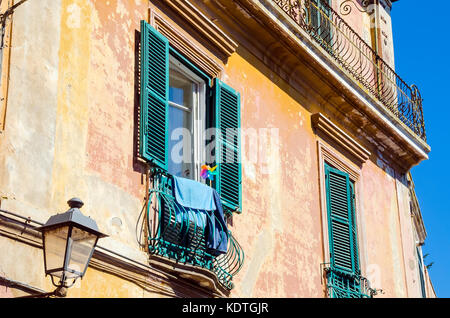Tuscania Italy Old House with Shutters, Province of Viterbo, Latium, Italy. - Stock Photo