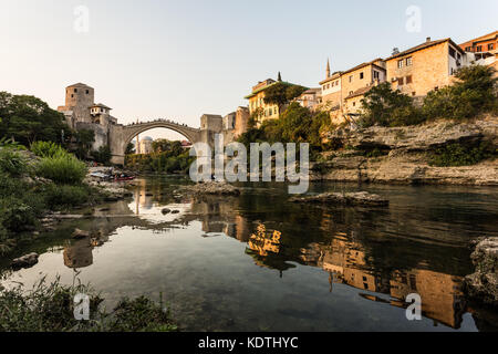 Sunset over the famous bridge in Mostar in Bosnia and Herzegovina in the Balkans in South Eastern Europe - Stock Photo