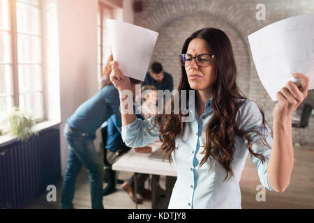 Picture of attractive young angry woman in office - Stock Photo
