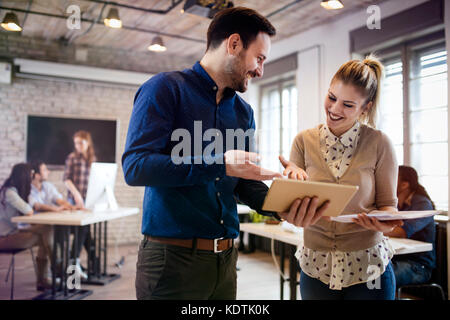 Picture of young designers using tablet in office - Stock Photo