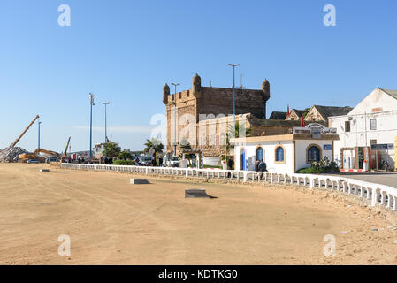 Essaouira, Morocco - December 31, 2016: View on the port and Citadel from the beach - Stock Photo