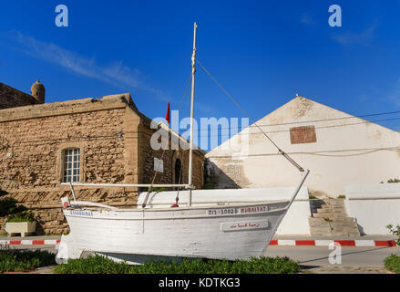 Essaouira, Morocco - December 31, 2016: White yacht monument in port - Stock Photo