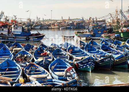 Essaouira, Morocco - December 31, 2016: Blue wooden fishing boats in port - Stock Photo