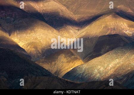 First light on the hills near Purmamarca, Quebrada de Humahuacha, Jujuy Province, Argentina - Stock Photo