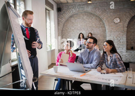 Picture of architect doing presentation to her colleagues