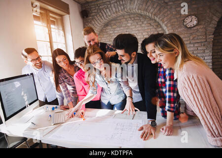 Portrait of young perspective designers having meeting - Stock Photo