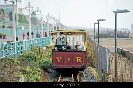 Brighton, UK. 16th Oct, 2017. UK Weather. Visitors enjoy a trip on the Volks Railway along Brighton seafront this - Stock Photo