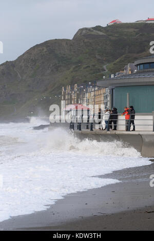 Aberystwyth, Ceredigion, Wales, UK  - High tide arrives with Storm Ophelia offshore across the Irish Sea - waves - Stock Photo