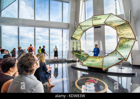 A tour guide educates visiting tourists on the history of New York city at One World Observatory, at the World Trade - Stock Photo