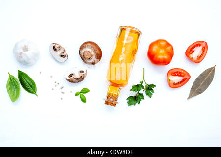 Various vegetable and ingredients for cooking pasta menu sweet basil ,tomato ,garlic ,extra virgin olive oil ,parsley - Stock Photo