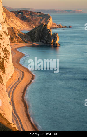 Figures on the beach, Durdle Door & St Oswald's Bay from Bat's Head, Purbeck, Jurassic Coast, Dorset, England, UK - Stock Photo