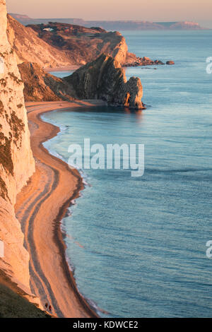 Two figures on the beach, Durdle Door & St Oswald's Bay from Bat's Head, Purbeck, Jurassic Coast, Dorset, England, - Stock Photo