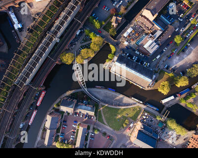 A drone view above castle field canals in manchester city centre - Stock Photo