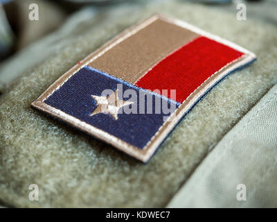 Close-Up of Texas flag patch on the bulletproof vest, shallow depth of field - Stock Photo