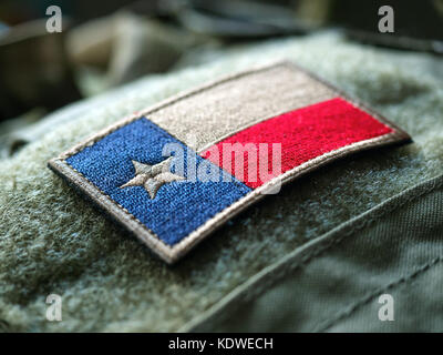 Texas flag patch on the bulletproof vest, shallow depth of field - Stock Photo