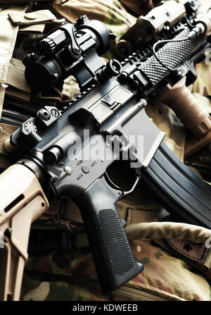 Tactical M4A1 (AR-15) carbine on bulletproof vest - Stock Photo