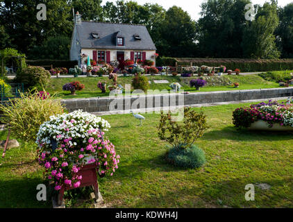A lock-keeper's cottage on the Nantes-Brest canal  between Josselin and Pontivy,  Seen while explore the Velodyssey - Stock Photo