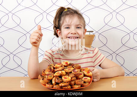 happy little girl with bruschetta and thumb up - Stock Photo