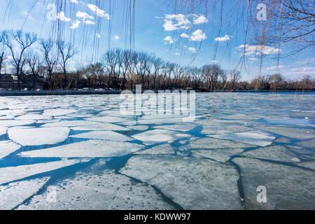 Broken ice at Houhai lake in Beijing, China - Stock Photo