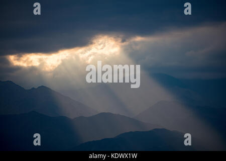 Crepuscular rays over the Andes from the vineyards of the Uco Valley nr Tupungato, Mendoza Province, Argentina - Stock Photo
