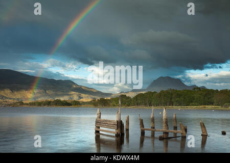 A rainbow over Loch Maree & Slioch, Wester Ross, Scotland, UK - Stock Photo