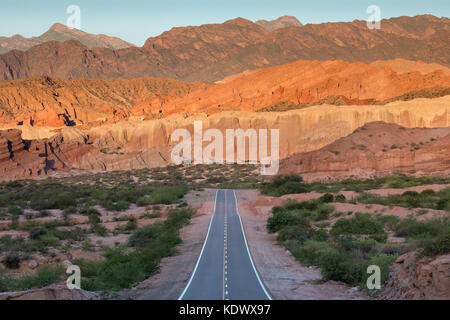 The road down the Quebrada de la Conches, Valles Calchaquies, Salta Province, Argentina - Stock Photo
