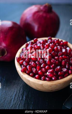 fresh pomegranate on a black background - Stock Photo