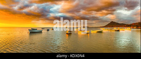 Fishing boats at sunset time. Amazing landscape.. Mauritius. Panorama - Stock Photo