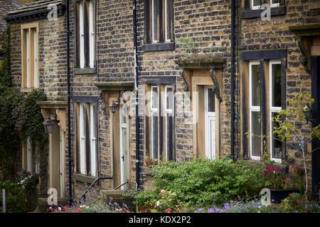 Pennines village, Haworth in West Yorkshire, England. stone terraced cottages on Bridgehouse Lane - Stock Photo