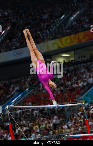 Nastia Liukin (USA) Women's Individual All Around Gymnastics gold medalist competing on the uneven bars at the 2008 - Stock Photo