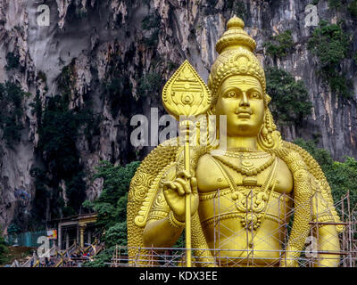 The world's second tallest statue of Lord  Murugan, the Hindu God of War,stands just outside the entrance to Batu - Stock Photo