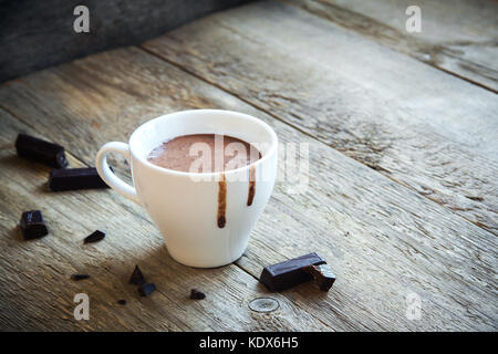 Hot Chocolate and chocolate pieces over rustic wooden background. Homemade Hot Chocolate Drink for Christmas and - Stock Photo