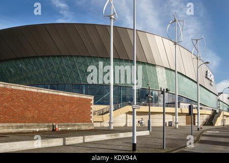 Liverpool, UK. Vertical axis wind turbines help power the Echo Arena (2008), on the River Mersey waterfront on the - Stock Photo