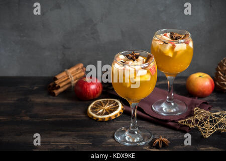 Homemade sangria (apple cider, punch, fruit wine) for autumn and winter holidays - festive Christmas, Thanksgiving - Stock Photo