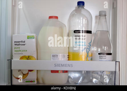 Essential Waitrose drink products in a fridge - Stock Photo