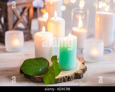Burning Candles In Transparent Glass Vases Indoor Stock Photo