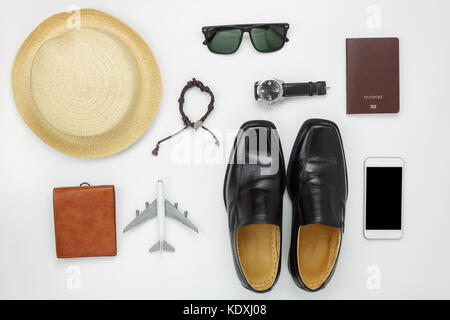 Flat lay of accessories travel and fashion men concept background.Essential items for trip on the white wooden at - Stock Photo